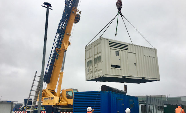 Generator being lifted into position at a warehouse site in Manchester